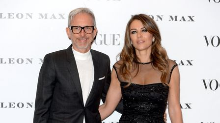 Patrick Cox and Elizabeth Hurley attend the opening night of the Vogue100: A Century of Style exhibi