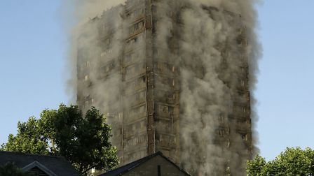 Smoke rises after the Grenfell Tower fire on Wednesday. Picture: AP Photo/Matt Dunham