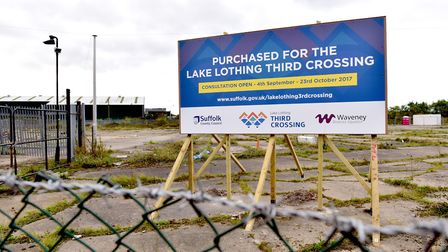 A sign has been put up showing that the land has been acquired for the third crossing project. Pictu