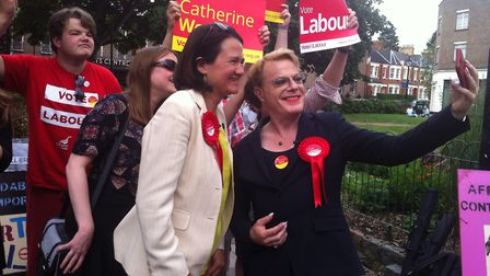 During the hour long visit, Izzard and West chatted to shopowners and drank espressos in a cafe.