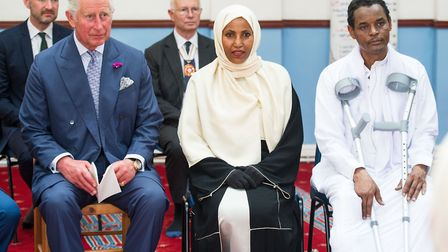 Prince Charles sits with Cllr Rakhia Ismail and her husband Yassin Hersi on a visit to Muslim Welfar