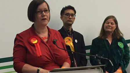 Meg Hillier delivers her acceptance speech. Dave Raval from the Lib Dems (centre) and Green candidat