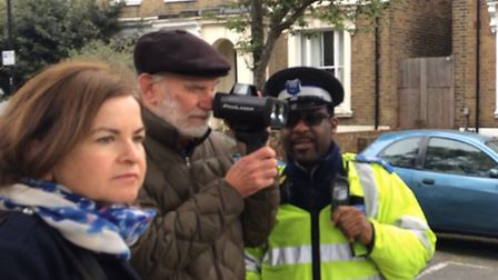 Brenda Puech from Hackney Living Streets with PCSO Jeffers and a volunteer testing out one of the mo