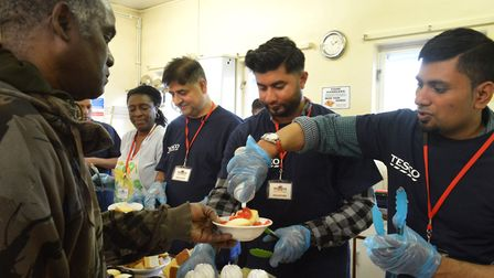 Volunteers from Tesco prepare and serve food on a Sunday afternoon at Storehouse. Picture: Polly Han