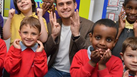 Cbeebies Magic Hands presenter Ashley Kendall with children from Frank Barnes School where he was fi