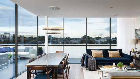Sliding walls of glass blur the line between the exterior and the interior