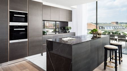 The marble floor and contrasting island make the open plan kitchen a talking point
