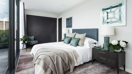 The master bedroom of the penthouse show flat takes light-filled to a new level