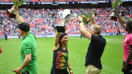 Hackney Jurassics captain Renee De La Cruz lifts her FA People's Cup during Saturday's FA Cup final