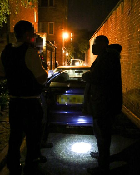 Police officers issue a Section 59 to a man caught in a car with a known prostitute.Photo: Catherine