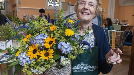Pat Simons with her winning basket of flowers. Picture: NIGEL SUTTON