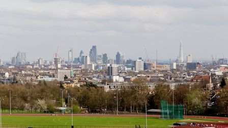 The City of London as seen from green and grassy Hampstead Heath