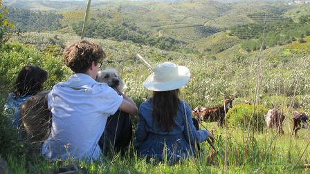 Gabriel, Beau and Ines taking a break from goat herding with Pepok. Photo: Hugo Farey