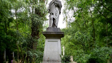 A statue of Isaac Watts at Abney Park Cemetary. Picture: Polly Hancock