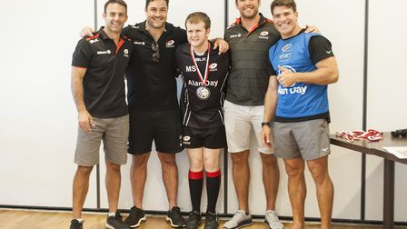 The Saracens players pose with one of the youngsters at the session (pic: Saracens RFC)