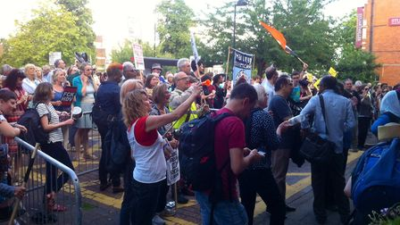The crowd yelled 'No HDV, no social cleansing', waved placards and banged on the windows in an attem