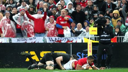 British & Irish Lions' Taulupe Faletau dives in to score his side's first try during the second test