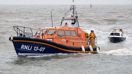 The small motor cruiser is towed in by the relief Lowestoft Lifeboat 'Reg.' Picture: Mick Howes/RNLI