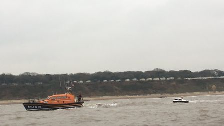 Lowestoft Lifeboat tows the motor cruiser in. Picture: Paul Marjoram