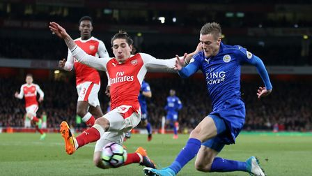 Arsenal's Hector Bellerin (left) challenges Leicester City's Jamie Vardy during the Premier League m