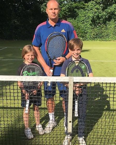 Danny Ward on the court with two young hopefuls at Mercury Tennis Club