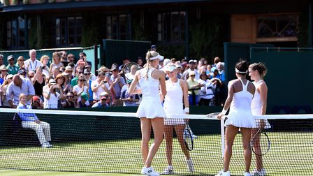 Harriet Dart (second left) and partner Katy Dunne shakes hands with Heather Watson (second right) an