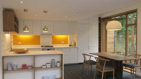 The once dark kitchen at the rear of the house has been transformed into a bright living space in ha