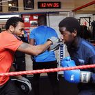 Coach and former boxer Jermaine Williams (left) doing pads with Kevin Ozee, 15. Picture: Dieter Perr
