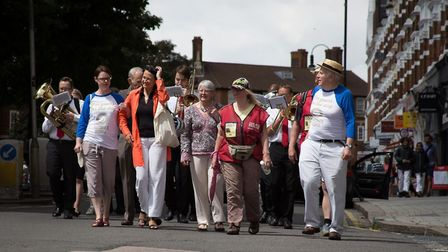 Local Gems march with the North London Brass band, Catherine West MP and MidSummer Muswell organiser