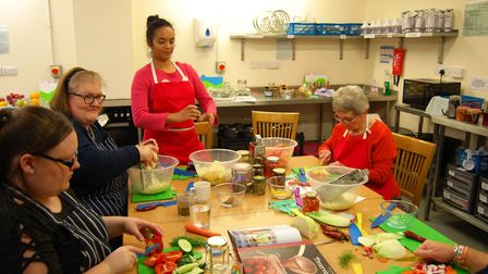 Artist Kasia Posen works with adult family carers at a previous Around the Table workshop. Pictures: