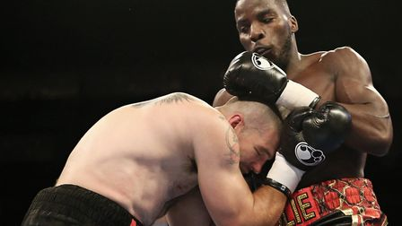 Lawrence Okolie hits out against Russ Henshaw (pic Natalie Mayhew/Butterfly Boxing)