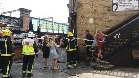 Some of the traders whose stalls were directly in the path of the fire were let up to view the damag