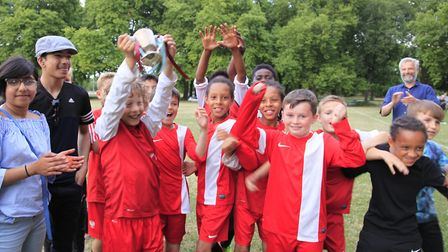 Rushmore pupils beat Millfields 6-0 to win the Solly Cup. Solly�'s daughter Liyya (L) presents the c