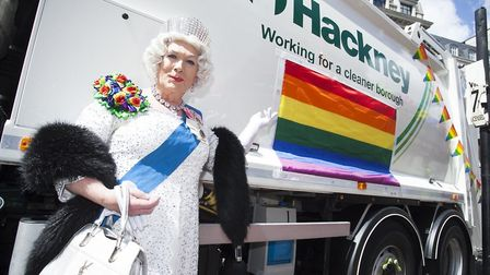 """A drag queen next to the council's bin lorry - used to spread the message """"Don't trash love"""". Photo:"""