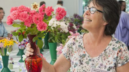 Susan Chaitow with her winning roses at Muswell Hill Horticultural Society's Summer show. Picture: N