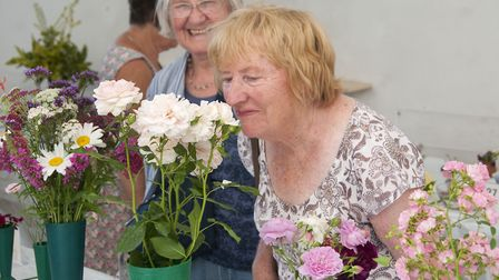Enjoying the scents at the Muswell Hill Horticultural Society Summer show. Picture: NIGEL SUTTON