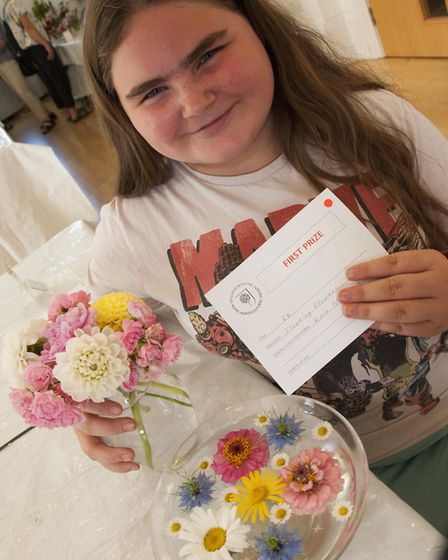 Kaia Milligan, 12, who won three prizes in the flower and cookery classes. Picture: NIGEL SUTTON