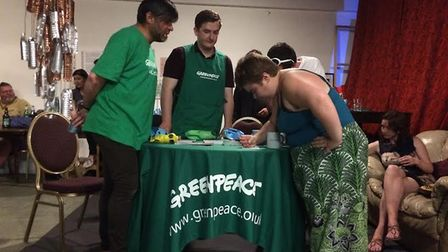 Greenpeace volunteers discuss the ocean plastics campaign with members of the public. Picture: Green