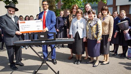 Kids N' Action were presented with a cheque for �5,000.
