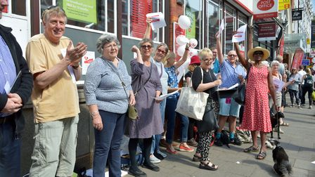 Activists formed a long queue and sang Return to Sender to protest against plans for the crown Pos