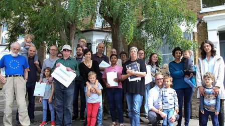Neighbours protest the demolition of a row of Victorian houses in Wilberforce Road on Sunday. Pictur