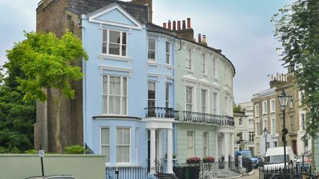 The exterior of the pretty pastel flat on Chalcot Crescent (Windsor Gardens in the Paddington films)