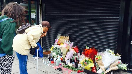 Flowers have been laid outside the Yours Locally shop in Kingsland Road, in memory of Rashan Charles