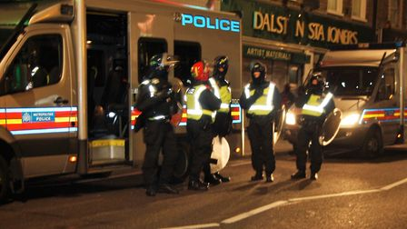 Police in Dalston on Friday night after protests broke out over the death of Rashan Charles. Picture