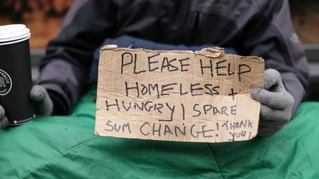 A file image of a homeless man holding a sign in London. Picture: Yui Mok/PA Wire