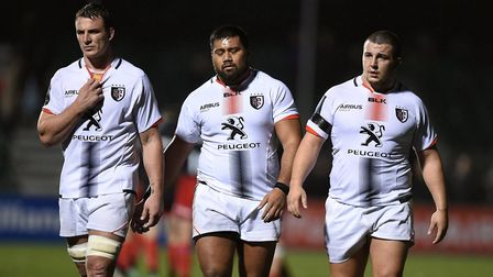 Christopher Tolofua (middle) looks dejected after losing with Toulouse at Saracens in the European C