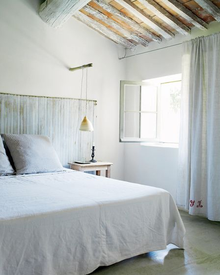 Shades of pale: A serene setting in a bedroom with white walls and the only colour provided by the n