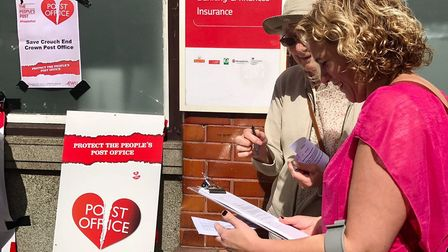 Campaigners speak to passersby outside Crouch End Post Office. Picture: Gary Watt