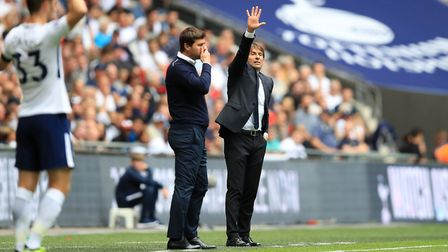 Chelsea manager Antonio Conte and Tottenham Hotspur manager Mauricio Pochettino on the touchline dur