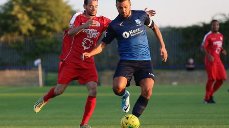 Michael Bryan of Harrow Borough and Ahmet Rifat of Wingate & Finchley battle for the ball (pic: Gavi